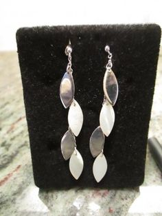 """Silver & Mother Of Pearl #Earrings.  Delicate """"leaves"""" cascade in alternating sterling silver and mother-of-pearl. These post earrings  make a fabulous gift for only $14.99.  FREE SHIPPING"""