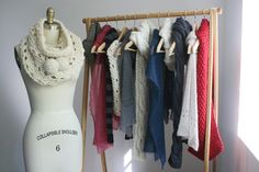 Hangers holding cowls at eye height + one modeled on Bust.
