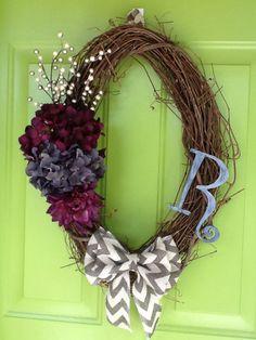 Oval grape vine wreath with chevron burlap bow and flowers. All from Hobby Lobby. 092614.  All season