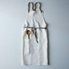 Look confident, feel confident, cook confident. This cross-back linen kitchen apron with slate ties is available now in the Food52 Shop. #apron #cookwear #beautiful
