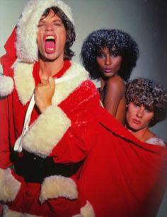 Mick Jagger, Iman and Paul Van Ravenstein 1977 Interview Magazine Santa Jagger Claus (via grooveland)
