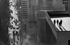 Obsessed with an image of four men on a rooftop in Brazil, the author went on a quest to find its origins.