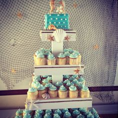Sea Themed Wedding Cake and Cupcakes, by Johnson's Custom Cakes & More    http://www.johnsonscustomcakes.com/wedding-cakes/sea-themed-wedding-cake-and-cupcakes/
