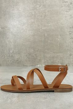 Your next vacay needs the Sonata Tan Ankle Strap Flat Sandals! Sleek straps of vegan leather start at an overlapping toe thong upper, and continue into an adjustable ankle strap with gold buckle.