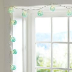 woven globe string lights from Pottery Barn Teen, except maybe have them in white.