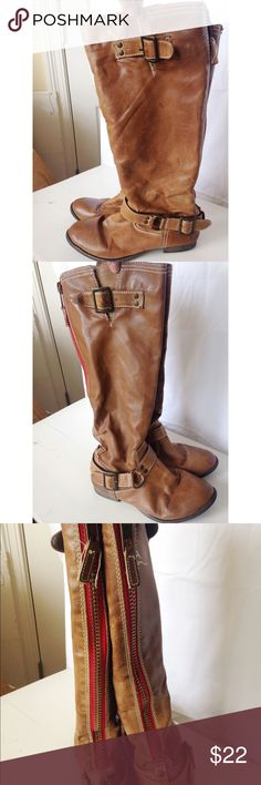 Tall brown boots Really cute pair of brown boots. Looks like real leather but is not. Not much stretch in the calf. Well-loved but in very good shape. Francesca's Collections Shoes Winter & Rain Boots