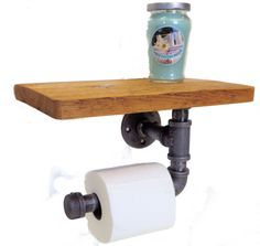 Reclaimed industrial toilet paper hold with shelf. Measures 12 inches long by 8 inches deep by 10 inches tall. Made with metal pipe and reclaimed lumber. Finished in a lacquer.