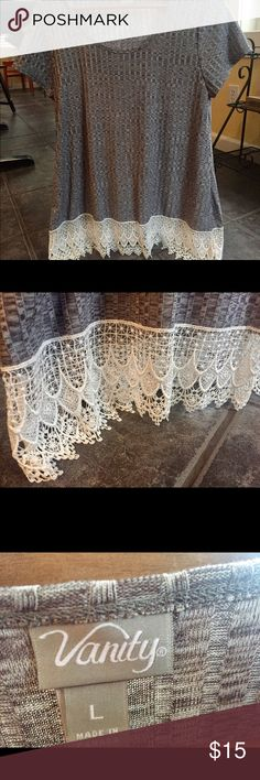 Large Vanity Lace-trimmed Shirt Beautiful! Very flowy and feminine. It's brand new without tags, never worn! It's a heathered grey pattern with white lace trim. Can definitely be dressed up or down. Vanity Tops Tees - Short Sleeve
