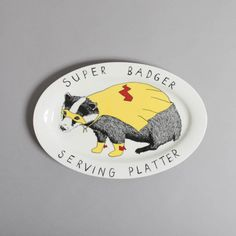 Bring quirky charm to your home with this Super Badger serving platter from Jimbobart. Beautifully crafted from bone china it is hand decorated & features an adorable black & white badger wearing a. Party Platters, Serving Platters, James Ward, Stoke On Trent, Ceramic Decor, Badger, Thoughtful Gifts, Creative Business, Unique Gifts
