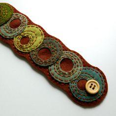 Shades of Green: Wool Felt Cuff Bracelet by LoftFullOfGoodies (Hand Embroidered & Ready To Ship). $24.00, via Etsy.