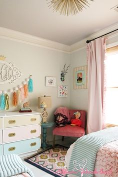 Creating a vintage chic little girl's wonderland bedroom with soft pastels, striped flooring and fun accessories from HomeGoods.  Sponsored by HomeGoods.