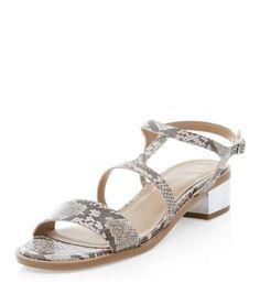 - Silver low metal block heel- Strappy design- Snakeskin pattern- Open toe design