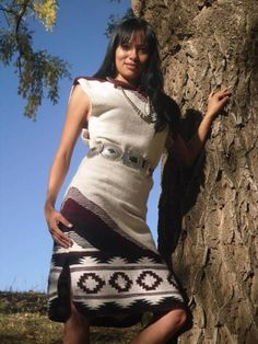 Traditional Navajo Wool Dress by: Genevieve Hardy Slim fit sweater dress with intricate pattern asymmetrically or at bottom