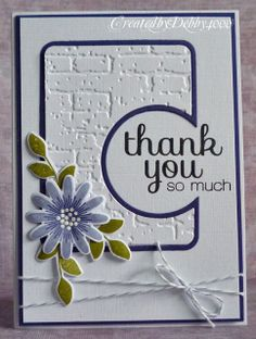 sweet thank-you card from A Scrapjourney ...white with purple and a bit of green ... brick texture .. luv the partial circle running off the edge ... sweet flower colored and die cut ... like it!!