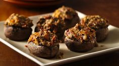 Treat your guests to these mushrooms stuffed with bacon and cheese made using Progresso™ Recipe Starters™ mushroom sauce – a tasty appetizer.