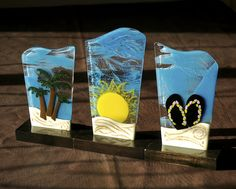 A series of fused glass trophies created by Holly Schinelle