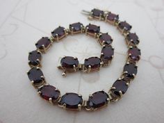 Vintage 10k garnet tennis bracelet 10.0cttw oval gemstone on Etsy $428 from HouseOfRene with Free Shipping Worldwide. https://www.etsy.com/shop/HouseOfRene