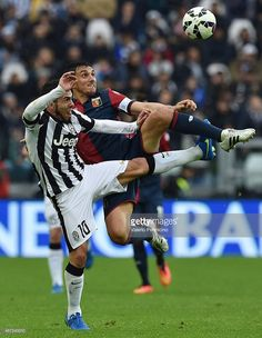 Carlos Tevez (L) of Juventus FC competes with Nicolas Burdisso of Genoa CFC during the Serie A match between Juventus FC and Genoa CFC at Juventus Arena on March 22, 2015 in Turin, Italy.