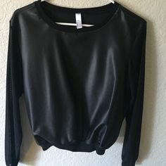 American Apparel Sweater Micro mesh sleeves, all black, sweatshop free. 80% nylon, 20% elastane. Hugs the hips (not oversize sweater type, more like bomber style.) American Apparel Tops Sweatshirts & Hoodies