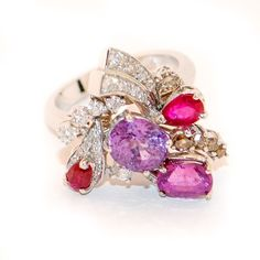 White gold ring with purple spinel rubies, natural brown diamonds and colorless diamonds