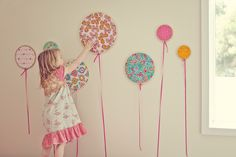 Balloons made from fabric  and cross-stitch frames.  way too clever