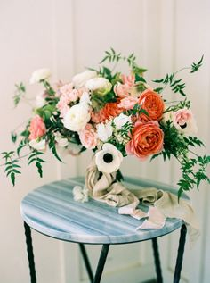 Coral and White Anemone Bouquet on a Marble Table | Danielle Poff Photography | http://heyweddinglady.com/playful-patterns-blue-coral-gold-summer-wedding/