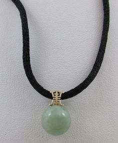 "14KT YELLOW GOLD CHINESE 10MM APPLE JADE ROUND PENDANT ON 30"" SILK CHORD"