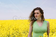 Lonely young woman in rape flower field — Stock Photo #1898261