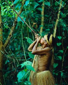 Yagua indian with a blowgun, Amazon jungle, near Iquitos, Peru.  Photo: Jim…