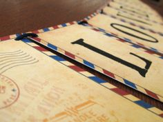 This old-fashioned airmail style would go great at a travel-themed wedding or shower!