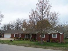 1994 Brick Ranch, level lot, large family room & living room w/free standing wood stove in Lakeview, AR.