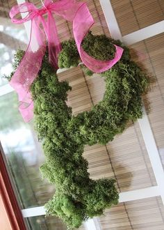 One large monogram letter covered in  reindeer moss (I'm going for faux for a longer lasting one, but the real stuff could probably also be used). Zippy moss on with some hot glue and string up your beautiful moss covered monogram letter with bright colored ribbon.