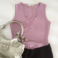 Lilac top with sheer design Cute top.  Purse  and pants not included. Tops