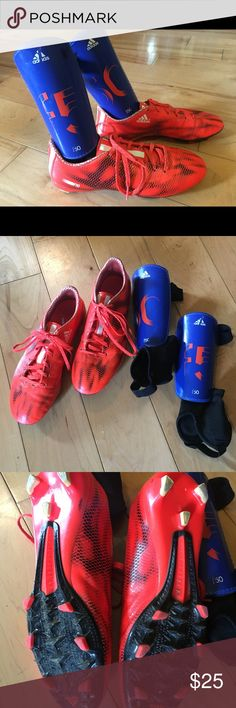 "Adidas Soccer ⚽️ Cleats with Shin Guards Adidas F10 Boys Soccer ⚽️ Cleats in Orange Black & White, Size 7 1/2, Two small black marks on cleat area, still have a lot of life left in these ""favorites""  Also including Adidas F50 Shin guards in Blue with Orange details one mark on adidas logo. adidas Other"