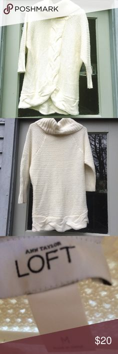 LOFT Ann Taylor Cable Knit Cowl Neck Tunic Sweater Loft Ann Taylor Cable Knit Cowl Neck Tunic Sweater made out of a soft acrylic, wool, and alpaca blend. There is a pulled thread on the back of the cowl neck but when folded down when wearing, it is not visible (shown). The color is an off white cream color. Great for keeping warm for the holidays! Measurements: Length: 21, Bust: 19. LOFT Sweaters Cowl & Turtlenecks