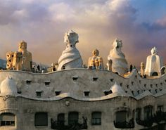 Barcelona.Catalonia, Spain.  La Pedrera                                                                                               - archit. Gaudí-  has an outstanding undulating façade which evokes incredible stone waves. Originally designed as a residential block, today part of the building is a cultural center.