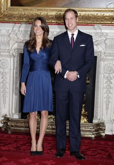 2010 - Young and in love: It doesn't get much better. Except it does, because the dress Catherine Middleton wore for her engagement portrait wasn't formal or fussy, nor was it made to fit. Rather, it was a draped Issa silk jersey number in a majestic sapphire color that plebes could buy with the click of a mouse.