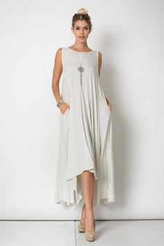 Long Draped maxi dress with pockets. This simple, unlined dress features pockets on both sides. Fabric : 95%RAYON 5%SPANDEX Made In : U.S.A.