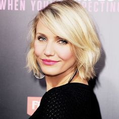 Push your bangs off your face and mist with a light hold hairspray [Cameron Diaz].