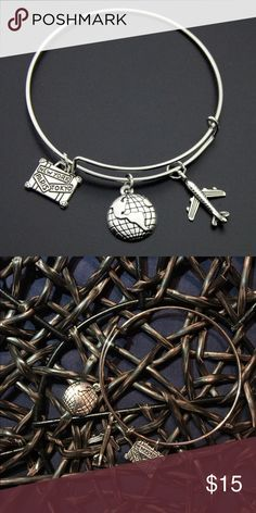 TRAVELLER WIRE BANGLE CHARM BRACELET BRAND NEW! Comes with three lovely charms; suitcase- New York, Paris and Tokyo, Globe and Airplane. Silver Plated Wire Bangle Charm Bracelet. Charms are oxidized this giving them a rustic color. Jewelry Bracelets