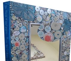 "@ Tomoko Honda    Repurposing found objects. A mirror, I created for a school art project made with washers and kids artwork embedded in bottle caps and washers  ""If the World is our Oyster the Ocean is our Pearl"" Treasure It! It was auctioned off."