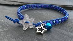 Cobalt blue leather and glass bead bracelet, glitter star button, bell, festive Wrap Bracelets, Beaded Bracelets, Star Buttons, Glitter Stars, Organza Gift Bags, Handmade Jewellery, Star Shape, Lampwork Beads, Leather Cord