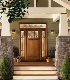 The stain glass windows of this front door add light and height to what could be…