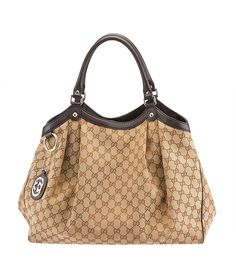 Gucci Sukey Beige GG Canvas & Brown Leather Large Tote--$644.00  #GucciHandbags #BuyDesignerHandbags  Buy this bag on our site, now!  http://www.cashinmybag.com/product/gucci-sukey-beige-gg-canvas-brown-leather-large-tote/