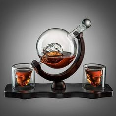 Skull Decanter Set With 2 Skull Shot Glasses - by The Wine Savant - and Beautiful Wooden Base - By Use Skull Head Cup For A Whiskey, Scotch and Vodka Shot Glass, Decanter 3 Ounces Shot Glass Home Gadgets, Gadgets And Gizmos, Vodka Shots, Skull Head, By Using, Pirate Theme, Shot Glasses, Decanter, Snow Globes