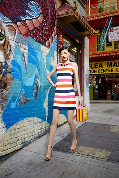 Make a bold move in a colorful, striped Vince Camuto dress. An embellished collar means no necklace needed. Choose a neutral shoe to let your frock do all the talking.