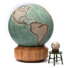 The huge Churchill Globe next to a small desk globe. 127cm / 50 inch terrestrial world globe, floor standing on roller bearings for 360 degree movement. Handmade and hand-painted by Belleby and Co Globemakers in London.