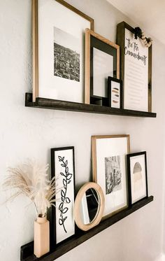 A good rule of thumb for styling picture ledge decor: use a mix of art, family photos, books, trinkets, mirrors, vases, and other items to keep it balanced. Decorating with picture ledges is a great way to fill in an empty space. Here are a few tips we've learned along the way. Home Living Room, Living Room Decor, Living Room Interior, Picture Ledge Shelf, Photo Ledge, Picture Ledge Bedroom, Ikea Picture Shelves, Wood Picture Frames, First Home