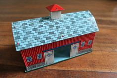 I loved playing with my red tin barn and farm animals...I had a truck too!