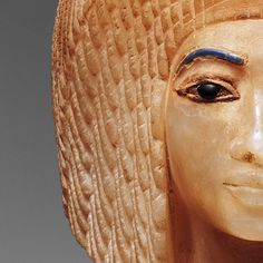 This is a stopper for a canopic jar with the face of Akhenaten's second wife, Kiya.